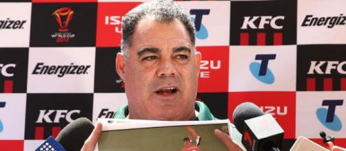 Australia coach Mal Meninga shows photos to media before an Australian Kangaroos training session at Suncorp Stadium. Source: Getty Images