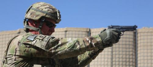 US military man firing a M9 Beretta pistol (Image credit - Chenee Brooks. Wikimedia Commons)