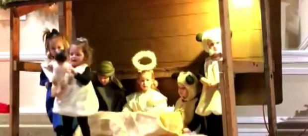 A 2-year-old, playing the sheep in a church nativity scene, stole baby Jesus [Image credit: Inside Edition/YouTube]
