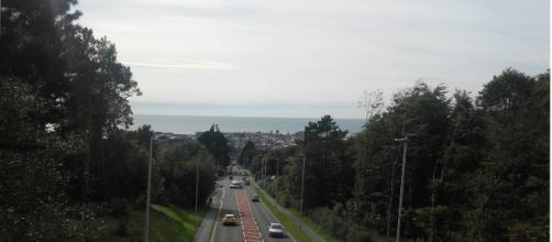 The whole town is seen from the top of a hill.