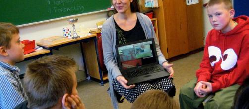 Teacher with laptop. - [Image credit: by Astrid Lomholt via Wikimedia Commons]