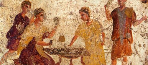 Saturnalia revelers [Image via Pompeii/Wikipedia]