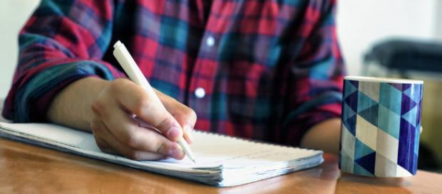 Person writing -- Daniel Foster/Flickr.