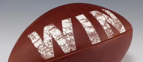 Trying to win fantasy football -- WIN football via Wikimedia Commons