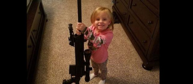 Adalynn Faith Calvert poses with a gun. [Photo via Instagram]