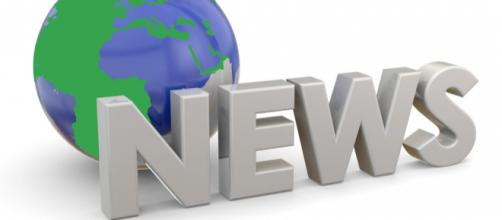"A sign stating ""News"" in front of a model of the world representing ""World News."""