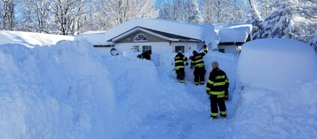 Rescuers in Lorraine, New York clear snow that blocked a residence. [image via Facebook/Lorraine Volunteer Fire Company]