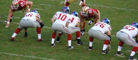 Eli Manning gets his starting job back after being benched last week. - [Image credit Flickr/Creative Commons]