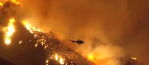 Fire encroaching upon Santa Paula, Ca in the AM hours. - [Artnewsive / YouTube screencap]