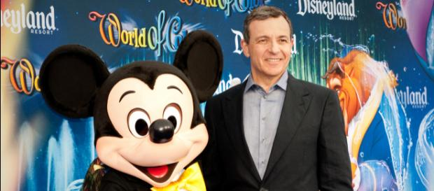 Bob Iger, chairman and CEO of The Walt Disney Co., and Mickey Mouse [Image Credit: Jagadish/Wikimedia Commons]