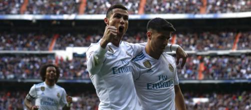 Cristiano festeja uno de sus dos tantos ante el Sevilla.