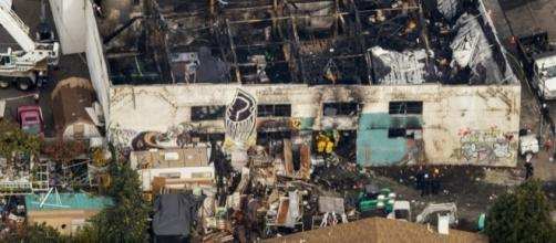 Debris can be seen outside the fire-ravaged Ghost Ship live/work warehouse in Oakland, Calif., where 36 died n December blaze. (Photo: The Columbian)