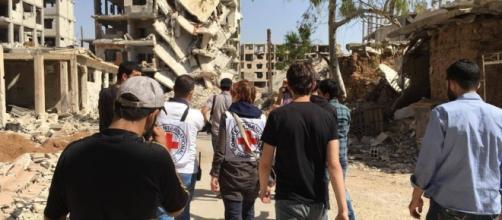 Syrian suburb receives aid   The Columbian - columbian.com