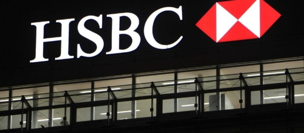 HSBC shares fall as annual profits drop