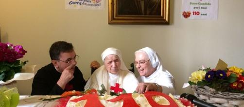 Sister Candida Begotti (in the middle) as she marks her 110 th birthday