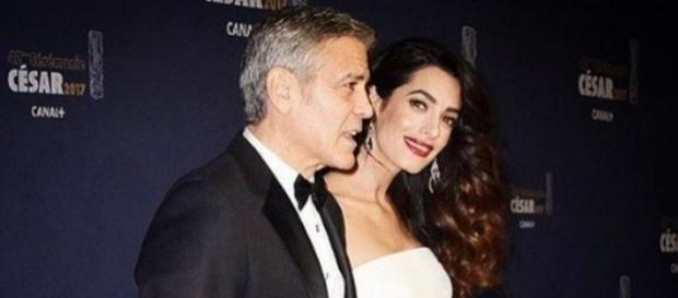 George y Amal Clooney en la alfombra roja