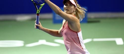 Eugenie Bouchard hitting an overhead during a match. - CBC Sports ... - cbc.ca (Take from BN Library)