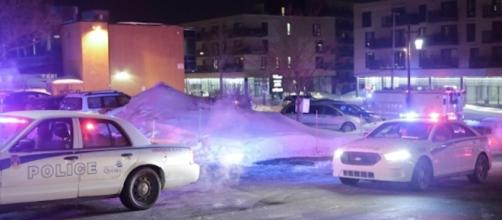 Police survey the scene of a shooting at a Quebec City mosque on Sunday January 29, 2017. Photo via Francis Vachon, THE CANADIAN PRESS
