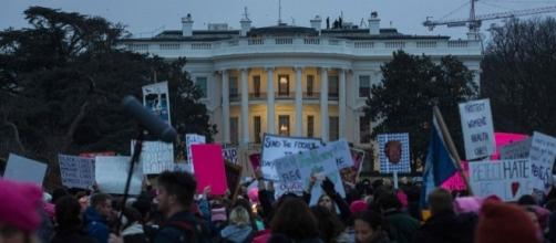 Anti-Trump Women's march protesters gather in front of White House. /Photo by Zach Gibson, Blasting News library