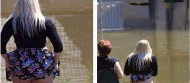 Mulher atravessa enchente e deixa seu corpo a mostra.