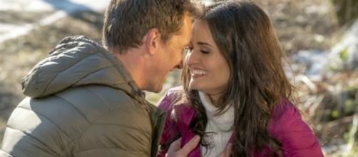 Paul Greene, left, and Danica McKellar in a scene from 'Campfire Kiss.' Photo © Crown Media. Photographer: David Owen Strongman. Used by permission.