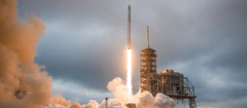 SpaceX postpones launch of communications satellite on its Falcon ... - theverge.com