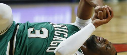 Grizzlies top Bulls 98-91, Wade sprains elbow | News OK - newsok.com