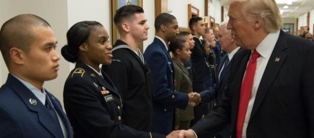 President Trump shakes the hands of service members on January 30 / Daniel Yeadon, Flickr CC BY-SA 1.0 Public Domain