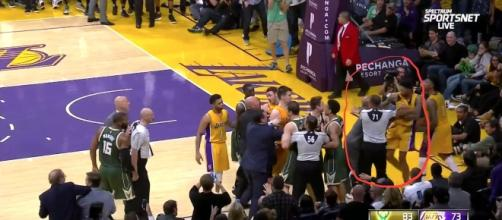 Brandon Ingram of L.A. pushed in a scuffle by a Milwaukee Bucks employee Photo credit: Mark Medina (MarkG_Medina) Twitter