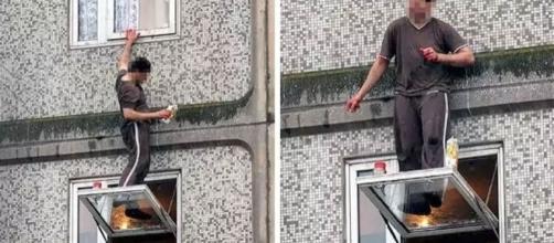 Homem limpando a janela sem proteção nenhuma