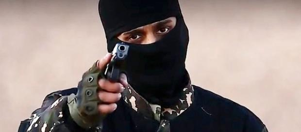 ISIS terrorist Jihadi John pictured without mask and clutching ... - mirror.co.uk