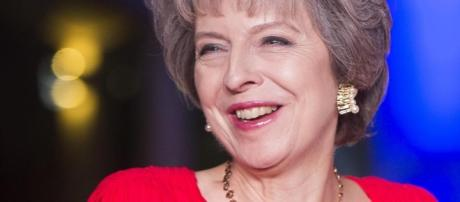 Theresa May becomes first British Prime Minister to be snapped on ... - thesun.co.uk