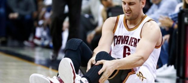 Bogut holding his left leg after injury. Pic via. Getty Images.