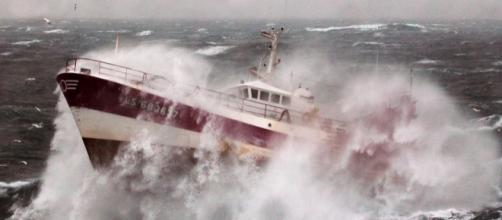 Fishing vessel caught in a storm. Royal Navy/Wikimedia
