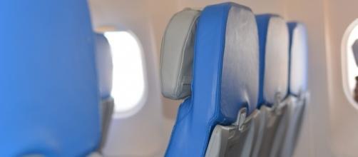 Seats aboard a plane/photo via Pixabay, public domain