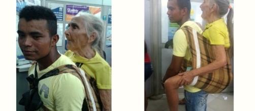 Parente carrega idosa com mais de 80 anos