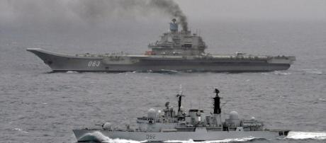 David Vs Goliath of the water: British warship is dwarfed by ... - dailymail.co.uk