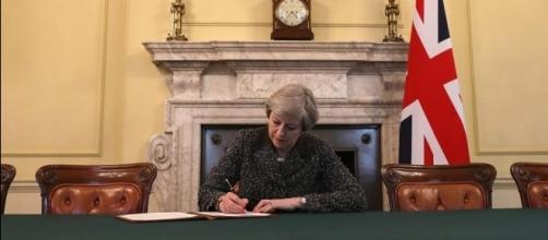 Theresa May heralds momentous day for Britain as she signs ... - thesun.co.uk