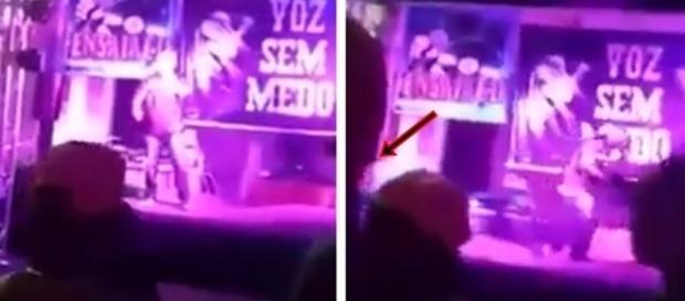 Na imagem o momento em que o rapper é atingido e o público foge assustado.