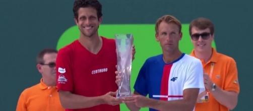 Kubot/Melo win Miami Open doubles trophy, Youtube, ATP World Tour channel https://www.youtube.com/watch?v=ed48Yve4oBk