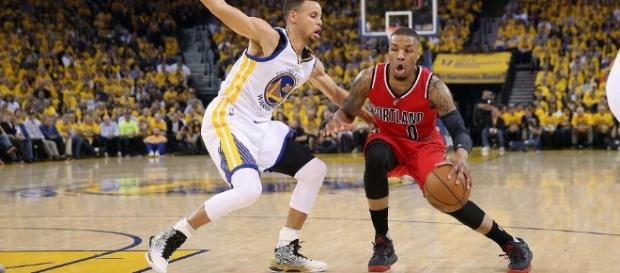 Can Damian Lillard help his team grab an upset road win in Game 2? [Image via Blasting News image library/inquisitr.com]