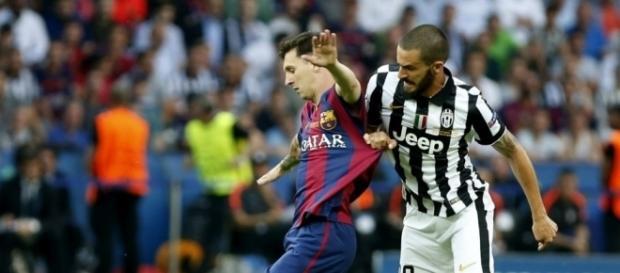 Messi y Bonucci en pleno partido