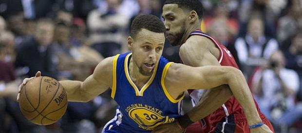 Steph Curry focused on the NBA Playoffs / Photo via Keith Allison, Flickr