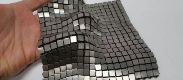 The metallic space fabric appears like a fusion of metallic tiles and chain mail [Image: NASA/JPL-Caltech]