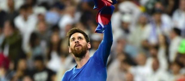 Lionel Messi celebrating after scoring his 500th goal and winning for Barcelona / from 'Hindustan Times' - hindustantimes.com