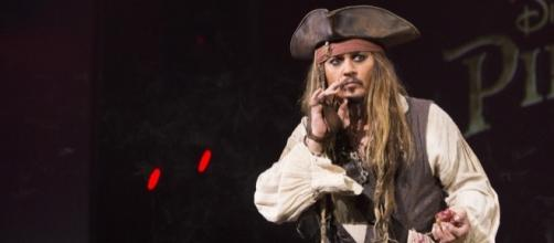 Johnny Depp Surprises 'Pirates' ride guests in Character as witty Jack Sparrow. / from 'Variety' - variety.com
