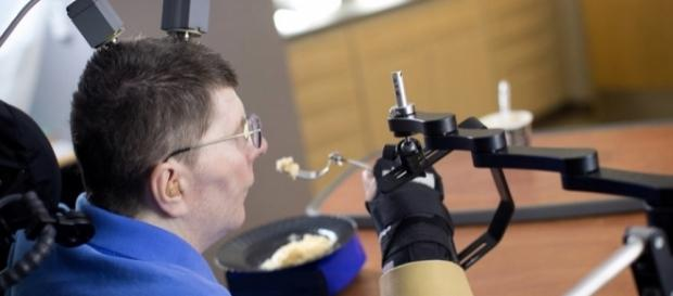A paralyzed man uses his thoughts to move his hands - npr.org