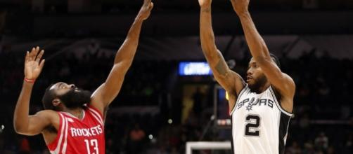 James Harden and the Rockets try to stop Kawhi Leonard and the Spurs in Game 6. [Image via Blasting News image library/twitter.com]