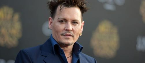Johnny Depp faces financial crisis after losing millions of his income. Who's to blame? (Photo via - startribune.com)