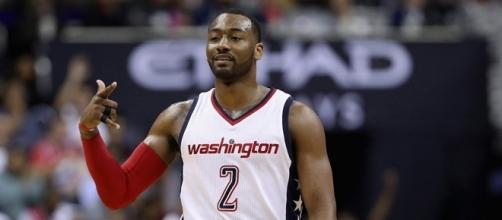 John Wall nailed a huge three with 3.5 seconds left to put Washington ahead for good. [Image via Blasting News image library/slamonline.com]